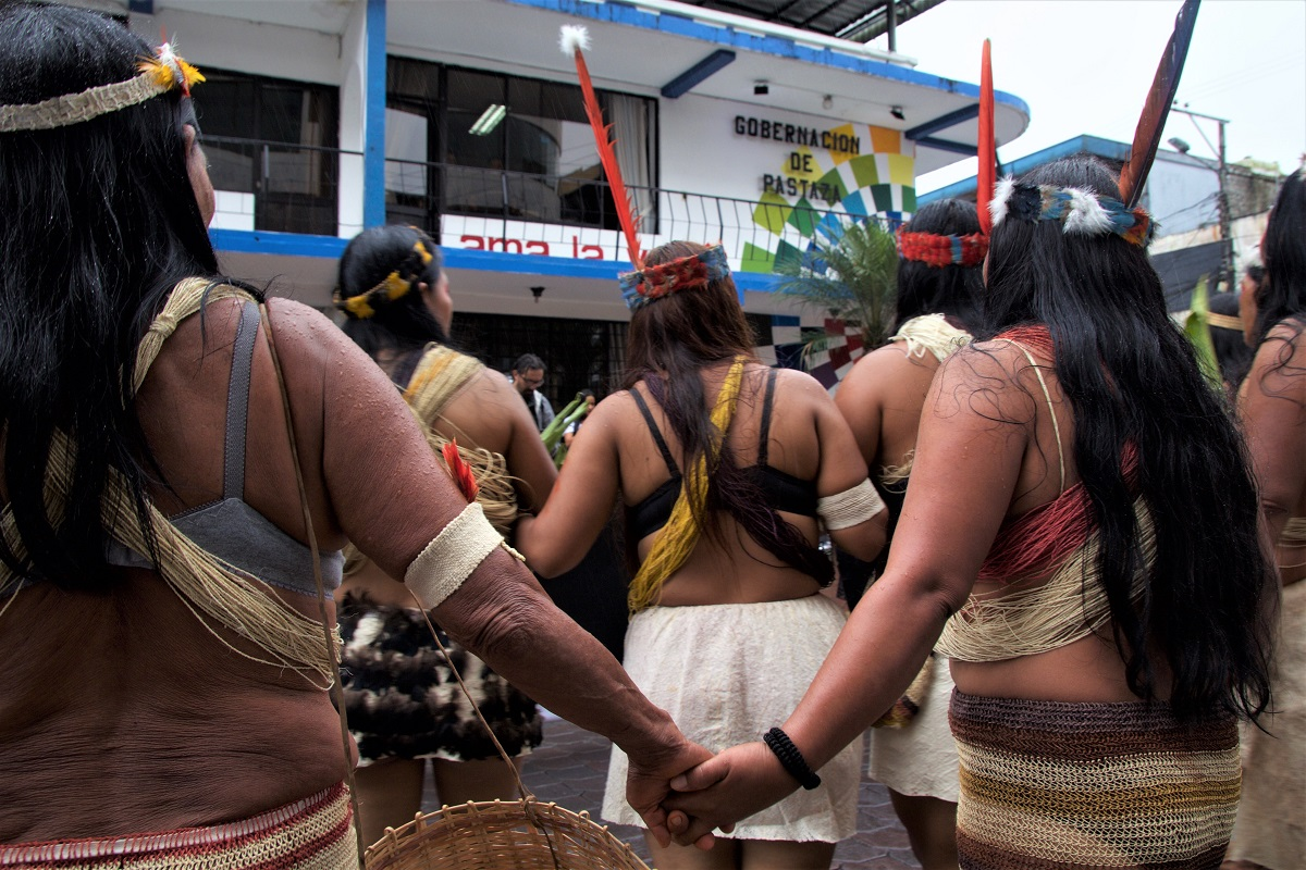 Women stop the International Women's Day march in front of the provincial government office in Puyo, Ecuador and demand that oil and mining extraction stop in their territory on March 8, 2018. Photo by Kimberley Brown/Mongabay.