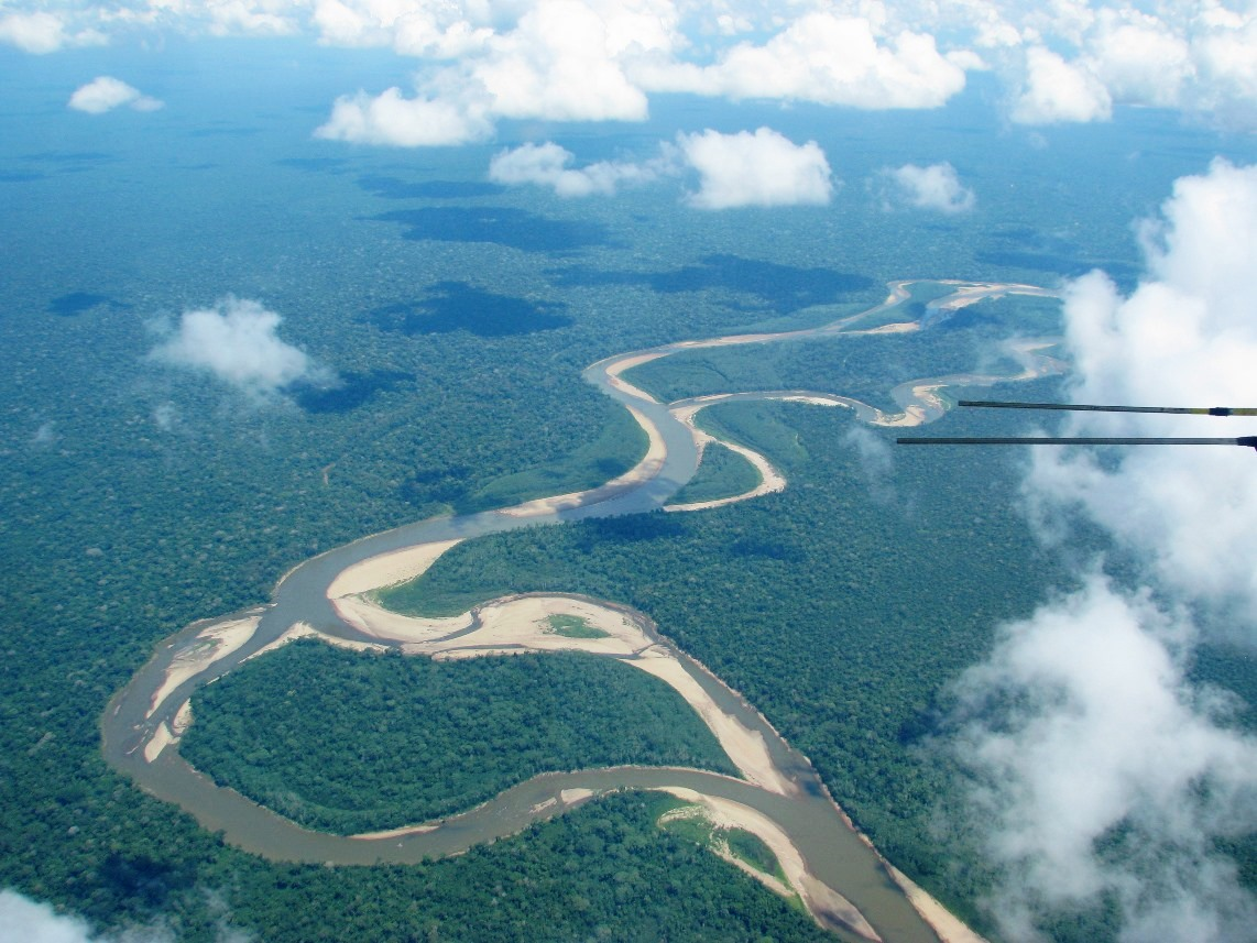 "The rainforest along a meandering river in southeastern Peru. Clouds block the ""view"" that satellites' optical sensors have of the Earth below."