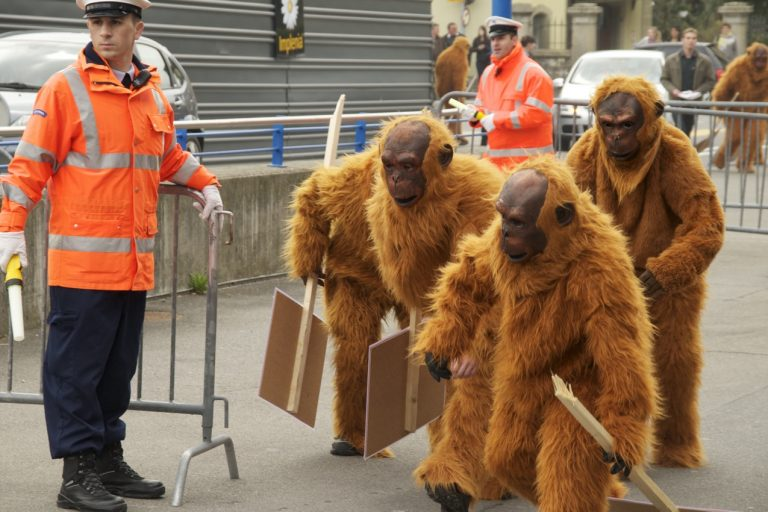 Greenpeace protesters in orangutan suits at Nestle's shareholder meeting. Street protests are one of Greenpeace's tactics for pressuring companies on their commodity sourcing practices. As a result of this particular campaign, Nestle adopted one of the earliest zero deforestation policies. That policy subsequently became the basis of other ZDPE commitments, which have now been signed by hundreds of companies around the world.