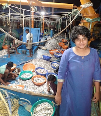 PhD student Tanvi Vaidyanathan aboard a trawl boat in Tuticorin, Tamil Nadu, India. Most trawlers in the area, including this one, are over the legal length and have engines over the legal power. The vessel did not target a particular species when it went fishing, and fishers are picking through the catch to find marketable sea life. What's left will be sold en masse, commonly for chicken feed. Photo by Amanda Vincent/Project Seahorse.