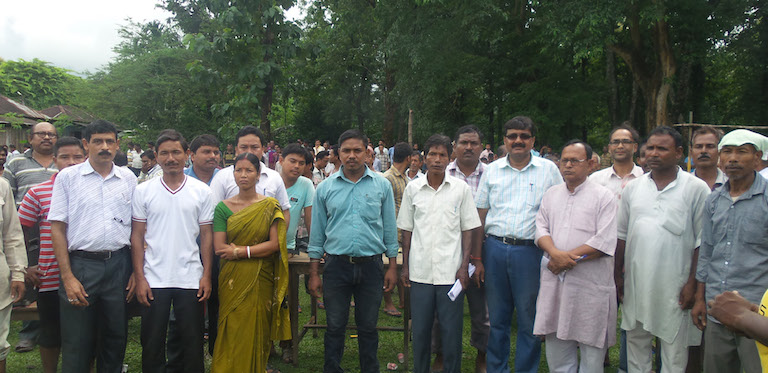 The Salkumar Joint Forest Management Committee  with ADFO Bimal Debnath (fourth from right, in sunglasses). Photo credit: Ratan Roy