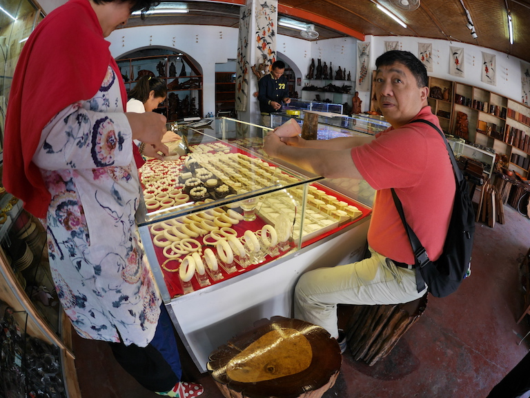 Chinese tourists shop for ivory trinkets in Luang Prabang, Laos. Image courtesy of Karl Ammann.