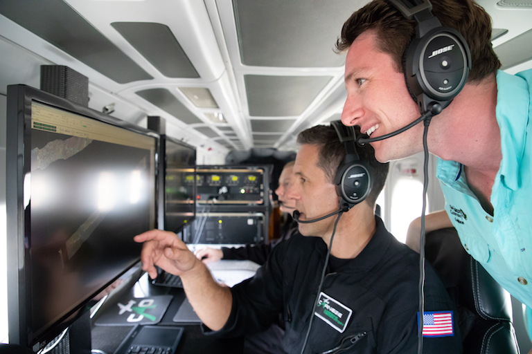 Greg Asner (left), founder of the Carnegie Airborne Observatory, and Joseph Pollock (right), coral strategy director for The Nature Conservancy, aboard the Carnegie Airborne Observatory. Image by Marjo Aho/TNC.