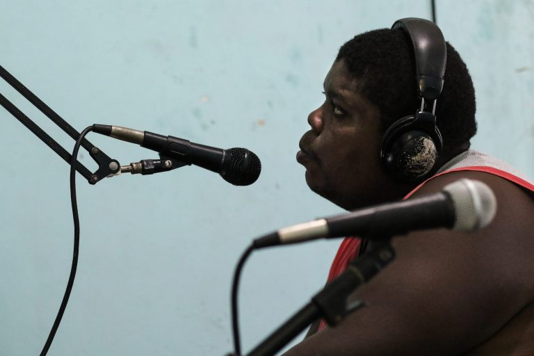 Cesar Benedict goes on air at Faluma Bimetu community radio station in Triunfo de la Cruz. Image by Christopher Clark for Mongabay.