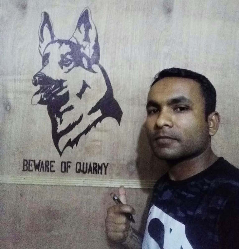 Quarmy's handler shows a sketch of his canine partner. Photo credit: Moushumi Basu/Mongabay