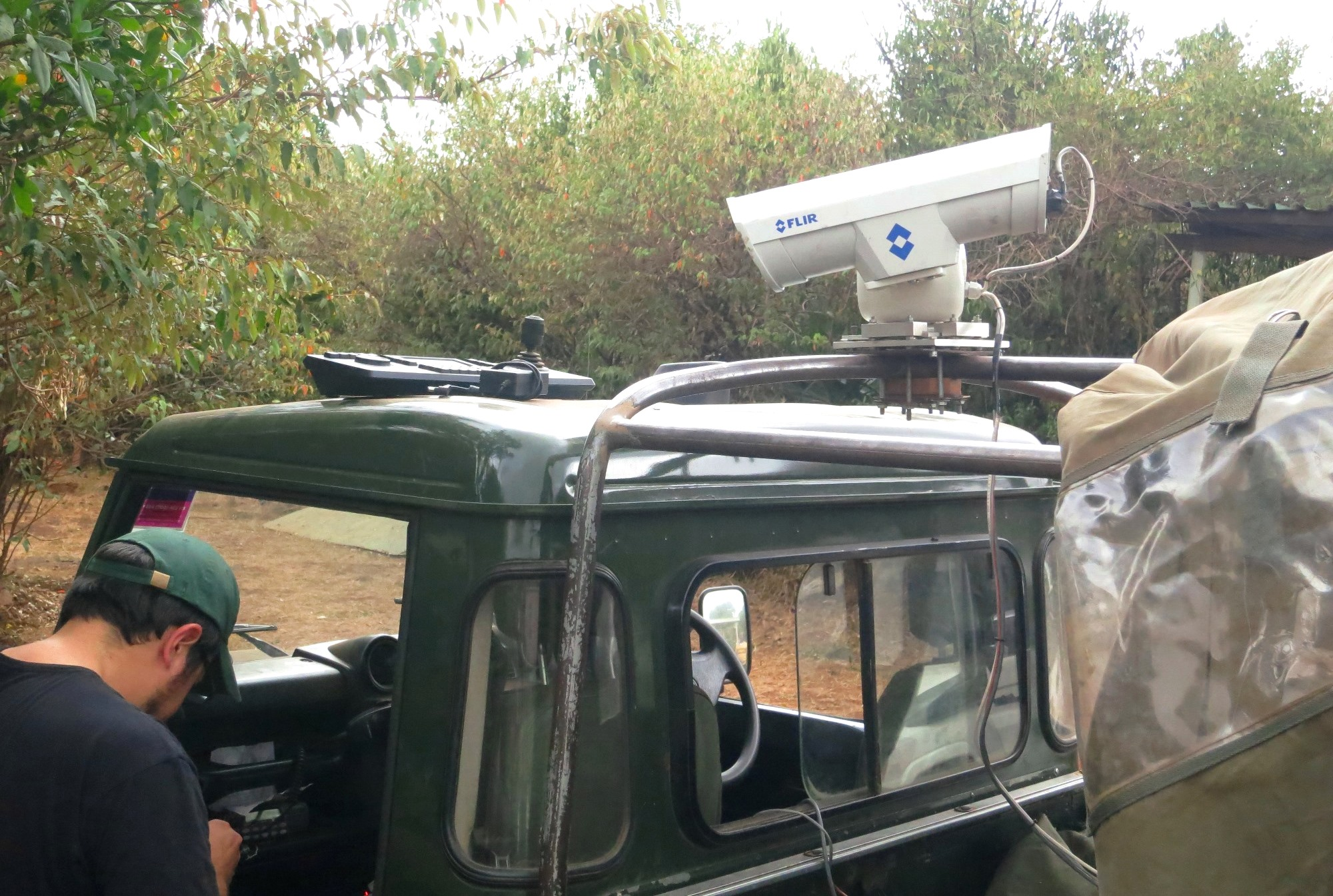 The FLIR thermal camera mounted on a vehicle in the Mara Triangle of Maasai Mara National Reserve, Kenya. A ranger operates the camera from within the vehicle and coordinates by radio with colleagues on foot.