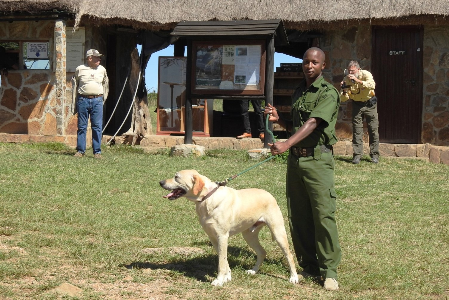 Gage and one of his handlers, ranger Anthony Kangethe, ready to go at the Purungat Bridge gate in Maasai Mara National Reserve.