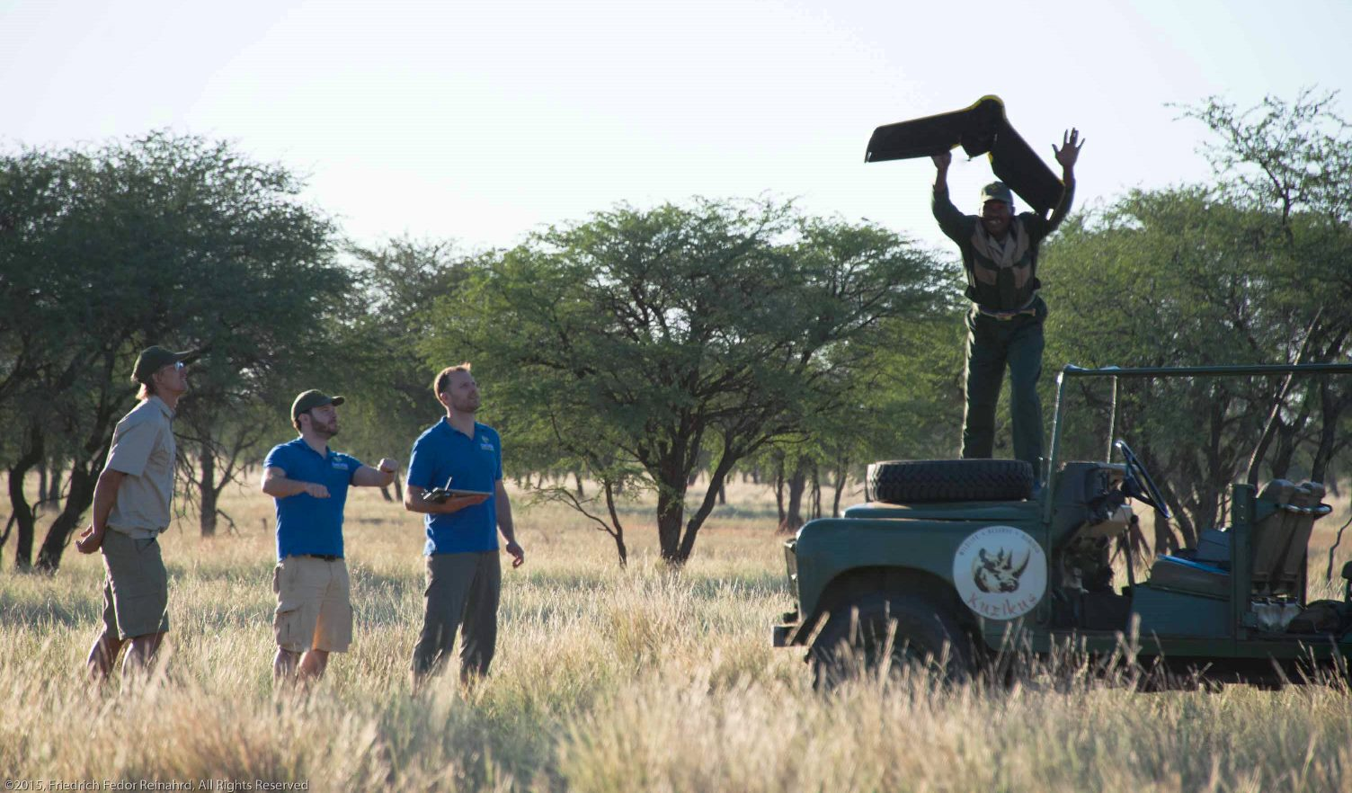 The research team launches the unmanned aerial vehicle (UAV, or drone) for a test survey at Kuzikus reserve, Namibia.