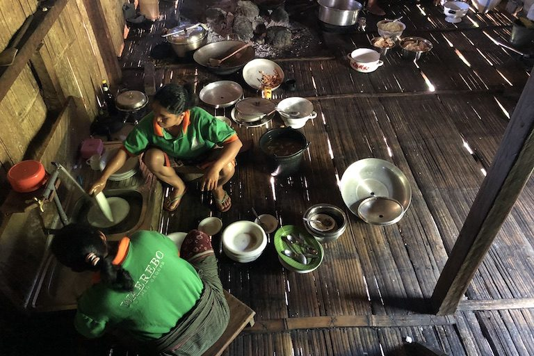 A cooking group prepares a meal. Image by Sarah Hucal for Mongabay.