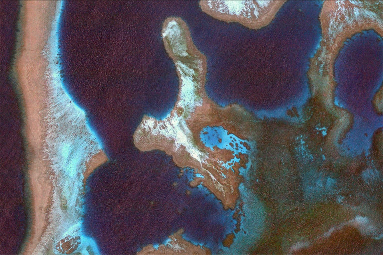 Google Earth image of reefs off New Caledonia. © DigitalGlobe.