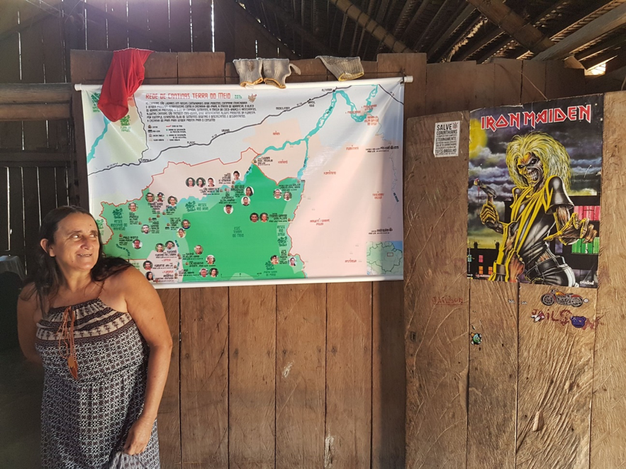 Dona Maria Laura, in her house which is also a cantina. On the wall, a map showing the location of the other cantinas in the network. Credit - Marcelo Salazar_ISA.png