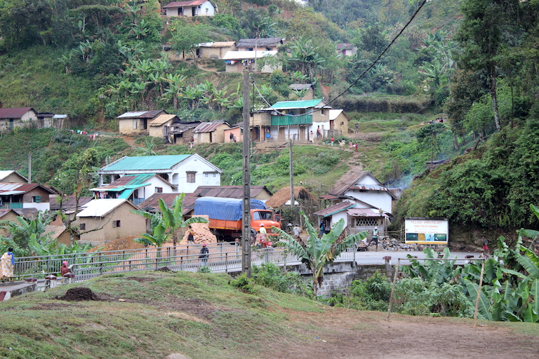 The village of Ambatolahy outside Ranomafana National Park in Madagascar, where bandits robbed residents and killed a conservation worker in July. (The photo was taken in 2017, just after electricity was introduced via the newly installed pole, center.) Image courtesy of Patricia Wright/CVB.