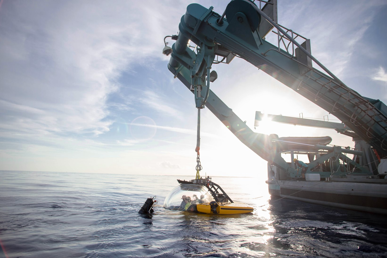 Scientists preparing to launch the submersible from the M/V Alucia.