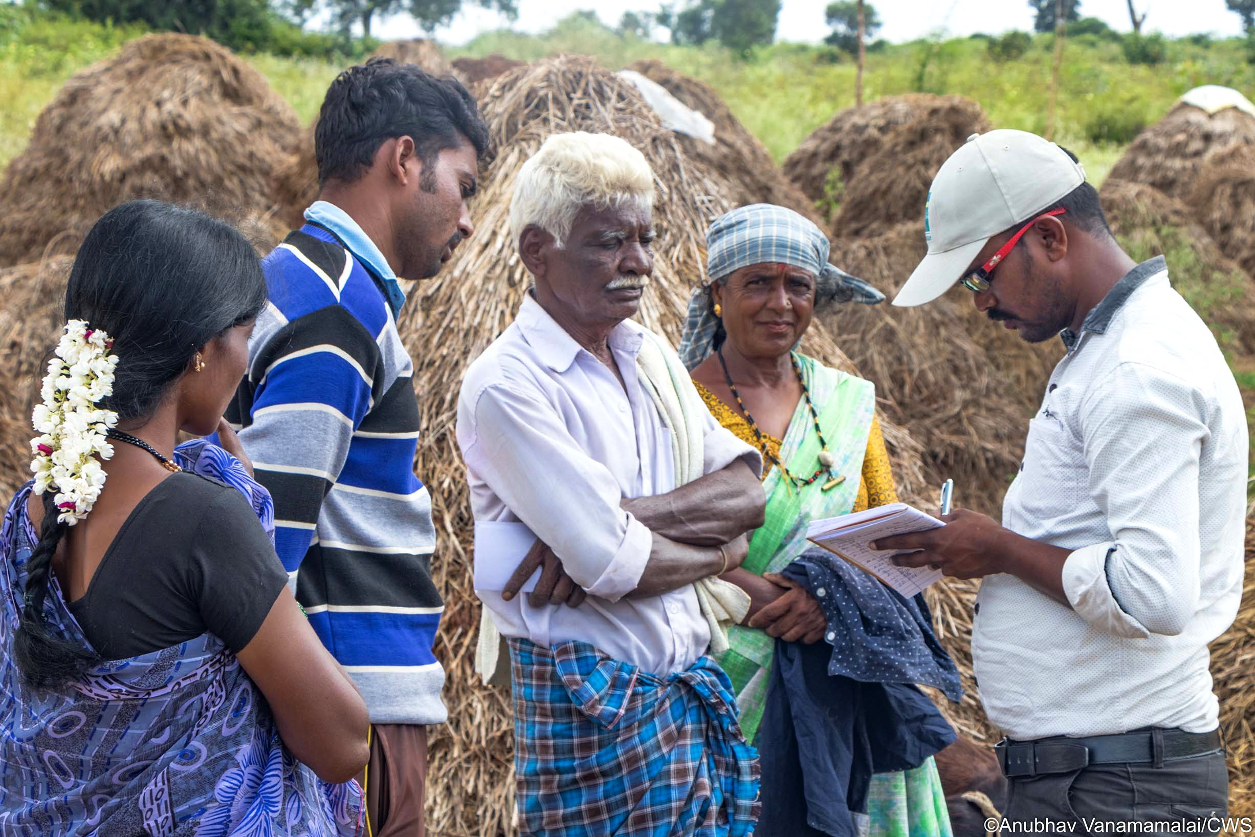 Taking down the details of wildlife damage with villagers. Attention to their plight and facilitating the compensation application process has helped to promote tolerance of wildlife.