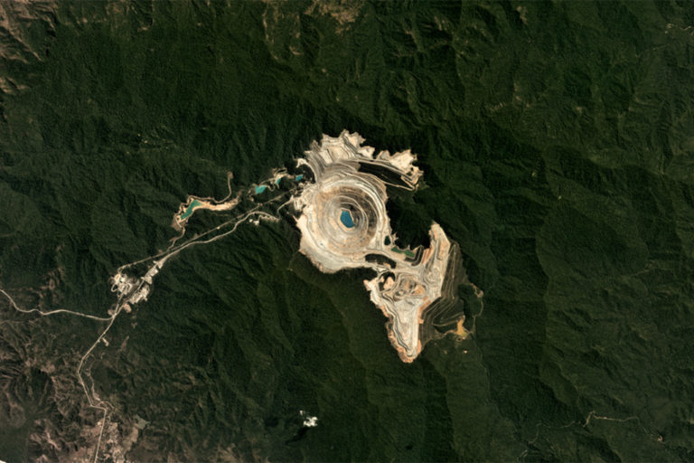 Planet satellite image of the open pit copper-gold mine on Sumbawa.