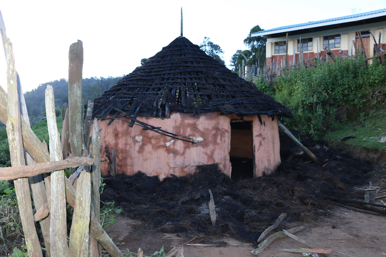 A house belonging to a Sengwer woman on the edge of Embobut Forest that was allegedly burned by Kenya Forest Service guards. A school behind the house was left untouched. Image by Anthony Langat for Mongabay.
