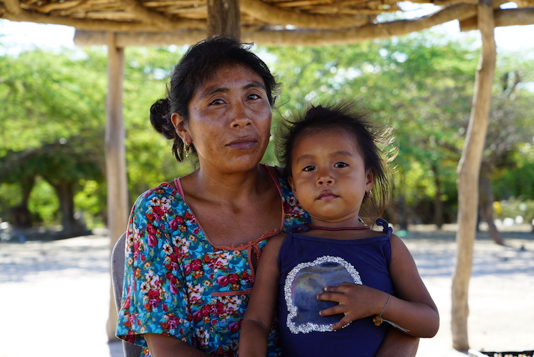 Mariella, whose husband is head of the Wayuu community of Wasimo, with her daughter. Image by Lucy Sherriff for Mongabay.