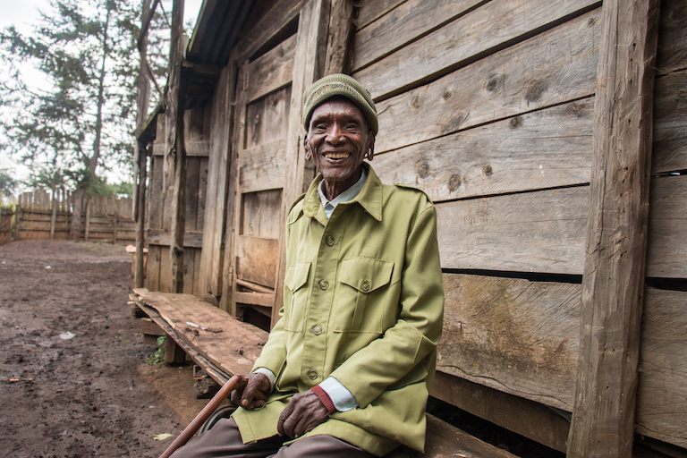 Paul Maritim Chumo, 86, an Ogiek elder, poses for a portrait near his home outside the Mau Forest Complex in western Kenya. Image by Nathan Siegel for Mongabay.