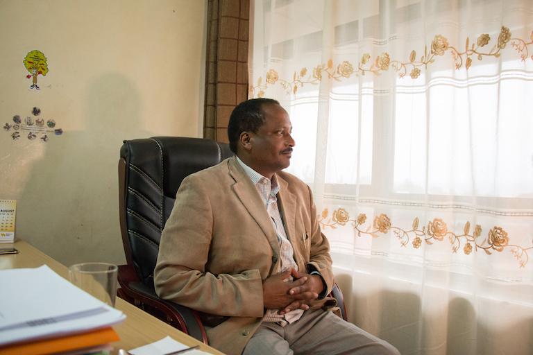 Daniel Kobei, executive director of the Ogiek Peoples' Development Program, poses for a portrait in the OPDP office in Nakuru, Kenya. Image by Nathan Siegel for Mongabay.