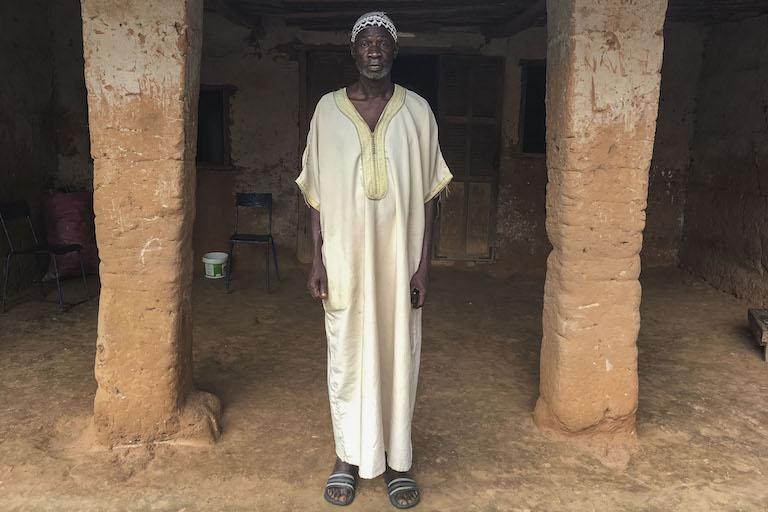 Mamina Goudiaby, president of Kawawana, in front of his home. Image by Jennifer O'Mahony for Mongabay.