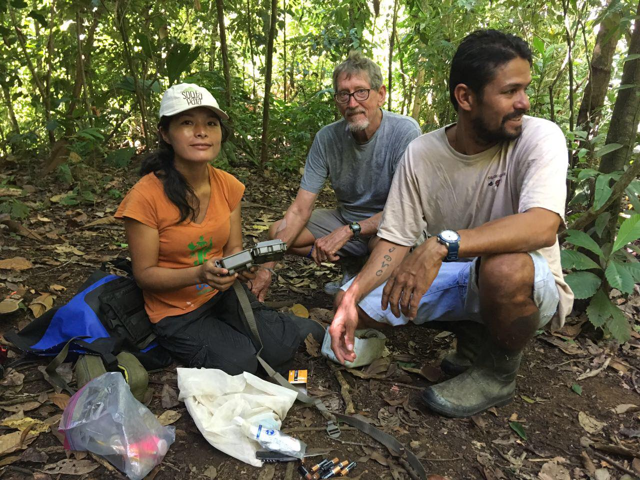 OC biologist Ruthmery Pillco Huarcaya accompanying Saladero Eco-Lodge owner Harvey Woodard and boat captain David on the edge of Piedras Blancas National Park installing camera traps.