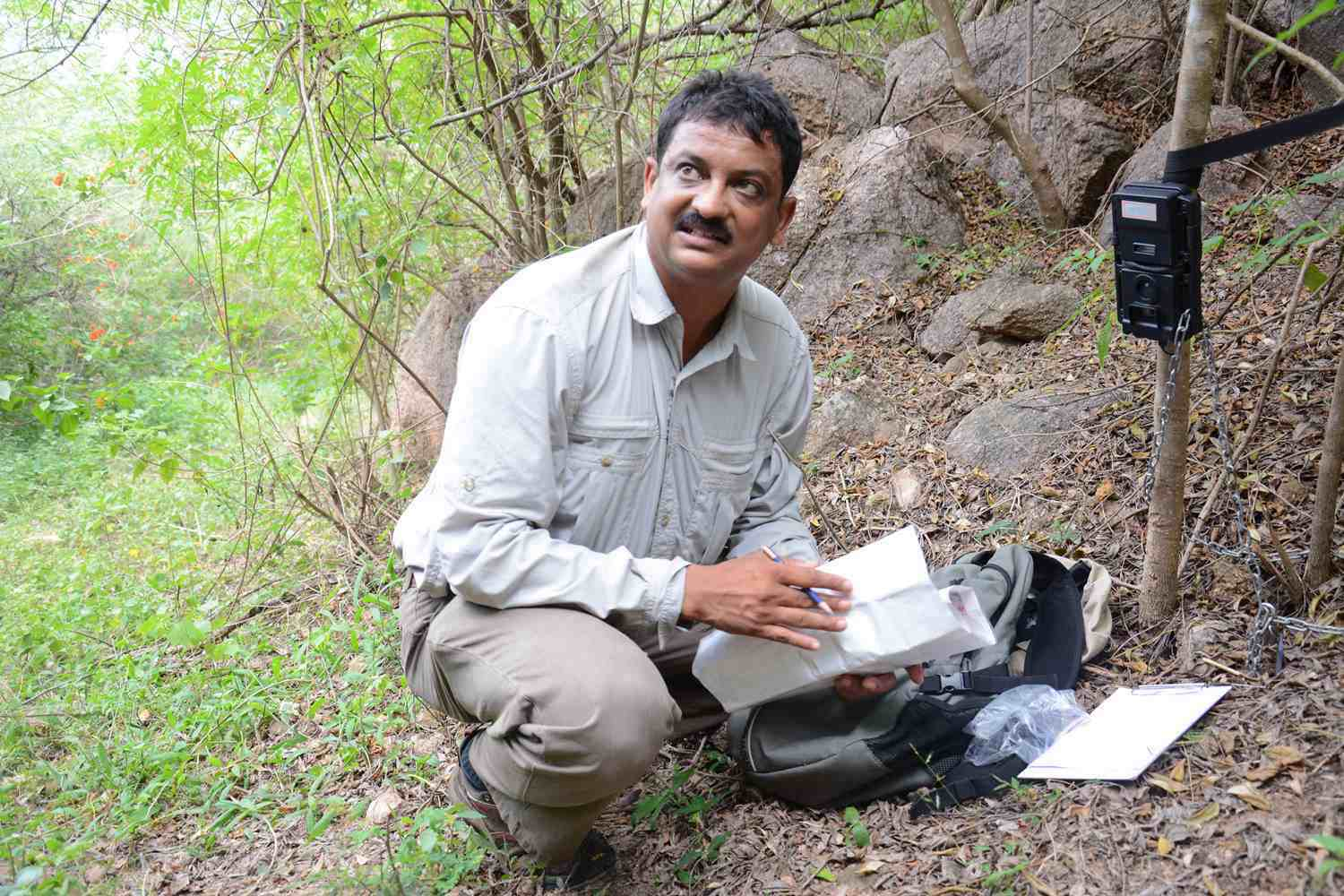 Lead scientist Sanjay Gubbi setting up a camera during the field study.
