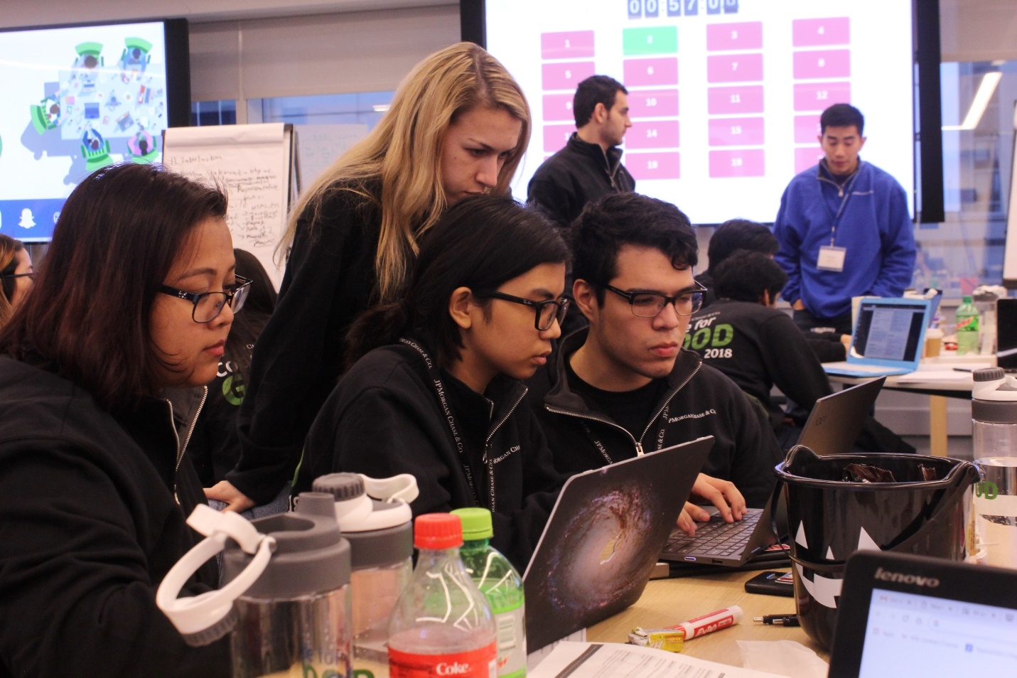 Programmers lost in thought troubleshooting a code bug. Hackathons can engage the talents of young software engineers in environmental or other do-good causes, which can both inspire the engineers and manifest in valuable products.