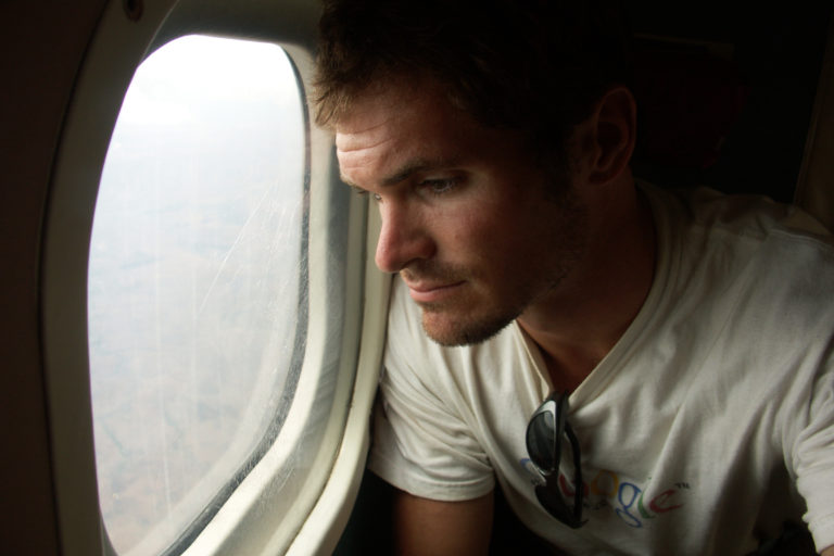 Rhett Butler looking out an airplane window on my return trip to Madagascar in 2004.