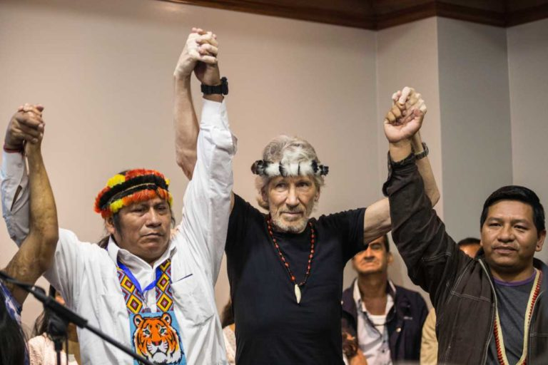 Indigenous leaders in Ecuador stand with Roger Waters at a press conference in Quito on November 20, 2018. Photo by Jonatan Rosas.