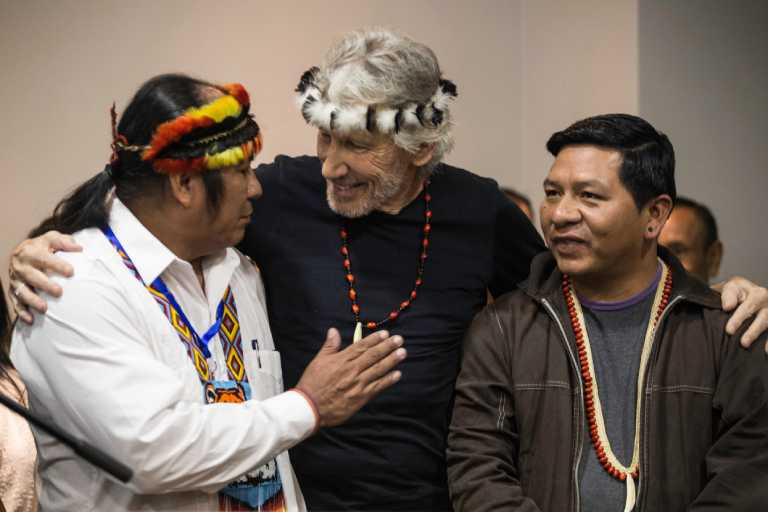 Roger Waters was given a chain and a headdress as a sign of respect by Rafael Padam (l) and other Amazonian leaders. Photo by Jonatan Rosas.