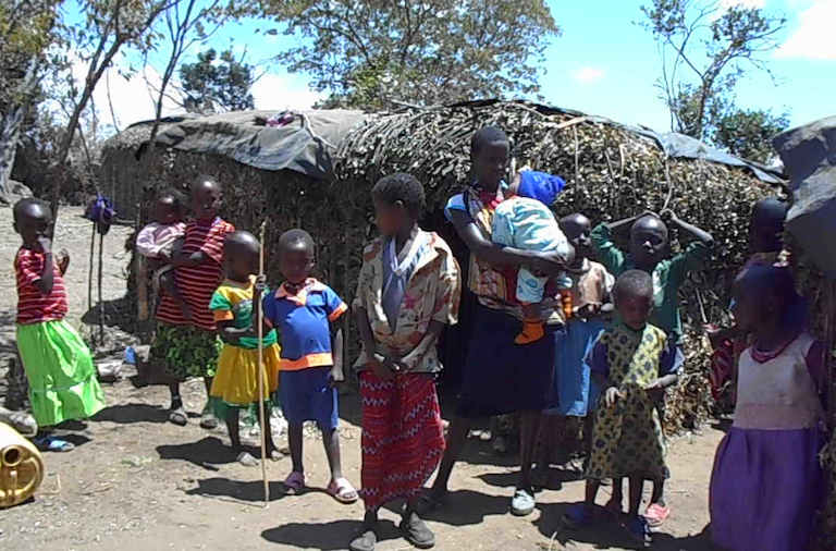 Yiaku children outside their houses. Image by Shadrack Kavilu for Mongabay.