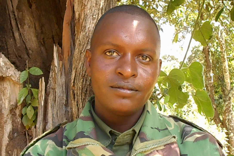 Lazarus Lentula, a 27-year-old leader of the Yiaku forest guards, who patrol and monitor Mukogodo for illegal activity. Image by Shadrack Kavilu for Mongabay.