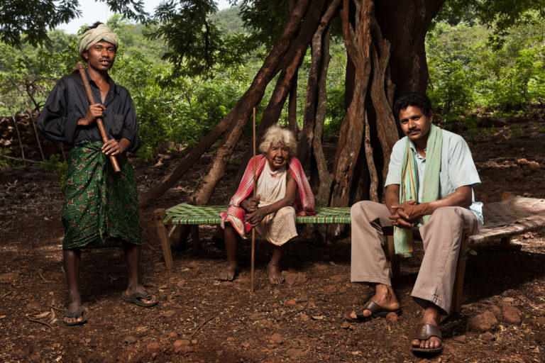 Farmer Drambu Jakesika, left, head priestess or bejuni Kumtadi Sikoka, center, and messenger or barik Sanyasi Takri from Hundijali village. Image by Indrajeet Rajkhowa.
