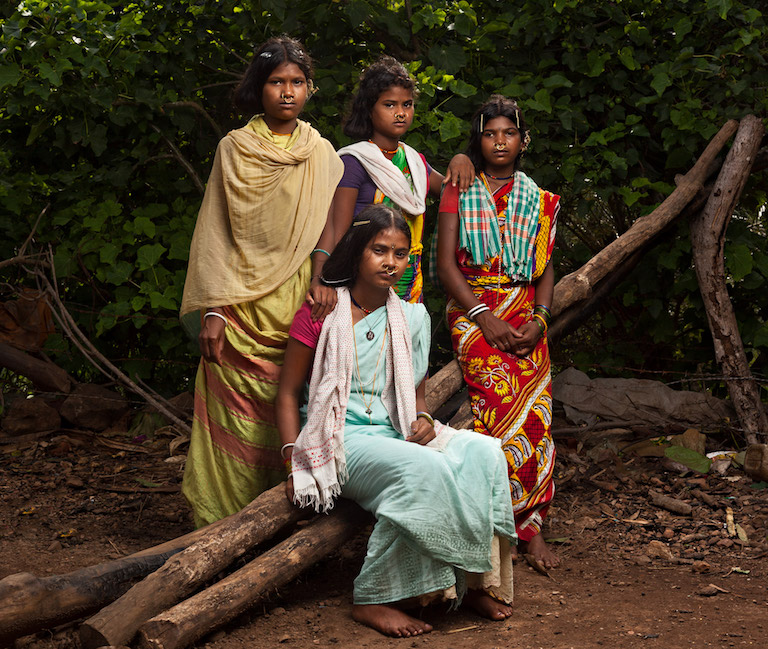 Eighteen-year-old Laxmi Kadraka, seated, poses with her friends in Rodango village in Niyamgiri. Image by Indrajeet Rajkhowa.