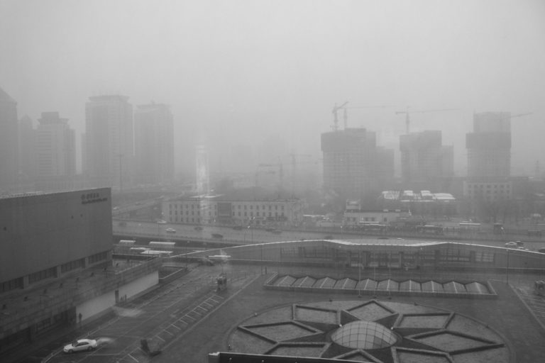 Beijing smog as seen from the China World Hotel, March 2003, during the SARS outbreak. Photo by Kevin Dooley.