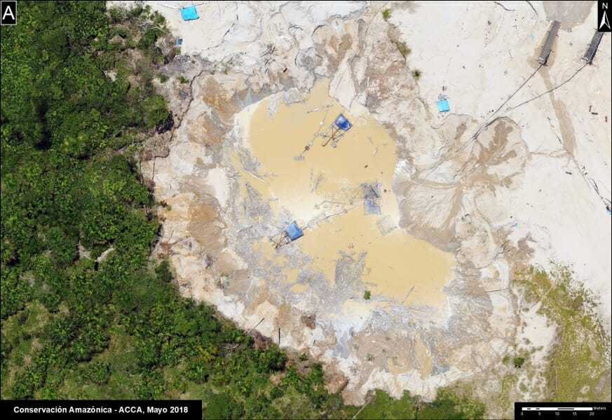 Devastation of the Madre de Dios forest landscape due to illegal mining, shown from a drone-based image along the newly paved Interoceanic Highway.