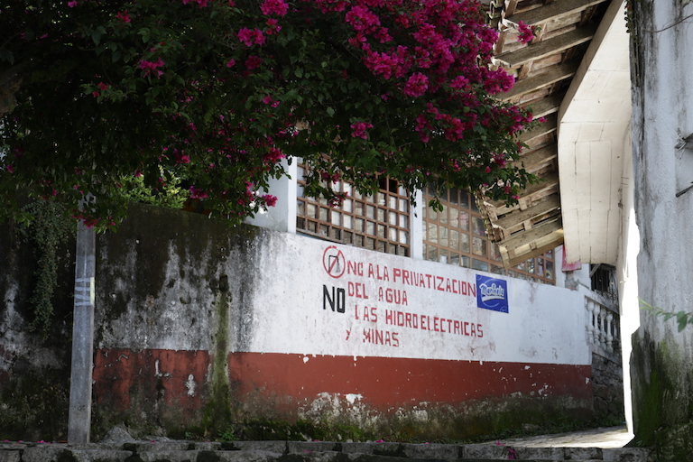 "A mural on a side street in Cuetzalan reads ""No to the privatization of water, no to hydroelectric dams, no to mines."" Image by Ethan Bien for Mongabay."