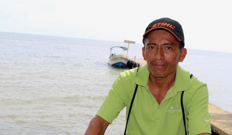Francisco Cuz Acal sits by the edge of the Río Sarstún. Image by Anna-Catherine Brigida for Mongabay.