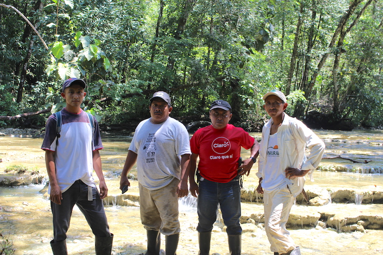 Valentin Suchite, second from left, and three other forest guards employed by the Río Sarstún Multiple Use Area. Image by Anna-Catherine Brigida for Mongabay.