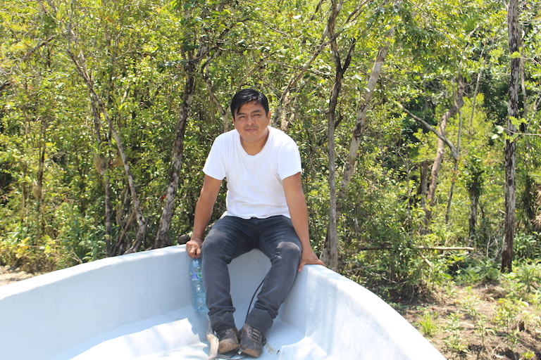 Emilio Pitan of FUNDAECO, one of two groups that manages the multiple use zone, sits on a boat as he finishes a visit to Tapon Creek, a Q'eqchi' community along the Río Sarstún. Image by Anna-Catherine Brigida for Mongabay.