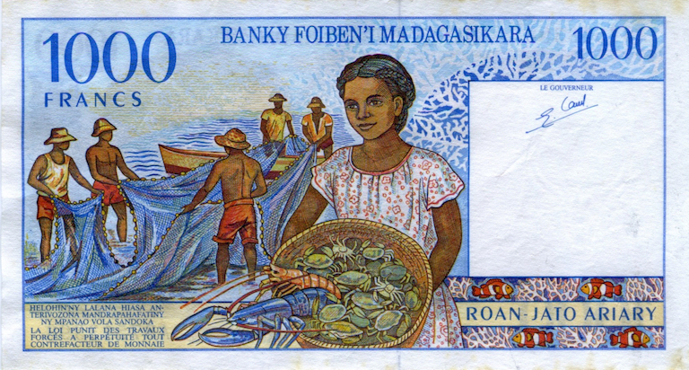 A 1,000-franc banknote from Madagascar, now discontinued, depicts a fishing community. Image by Rebecca Kessler.