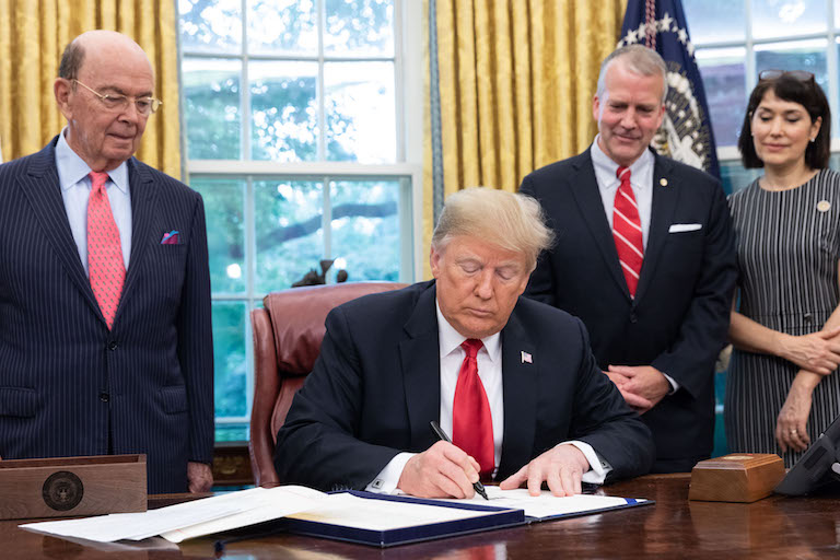 President Donald Trump signs the Save our Seas Act of 2018 on October 11, 2018. Image courtesy of the White House via Flickr.