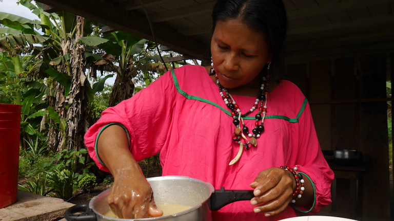 Flor Tungay makes a mildly alcoholic drink called chicha from fermented plantains using water from a rainwater catchment system in her village of Aboquehuira. Image by Dan Collyns for Mongabay.