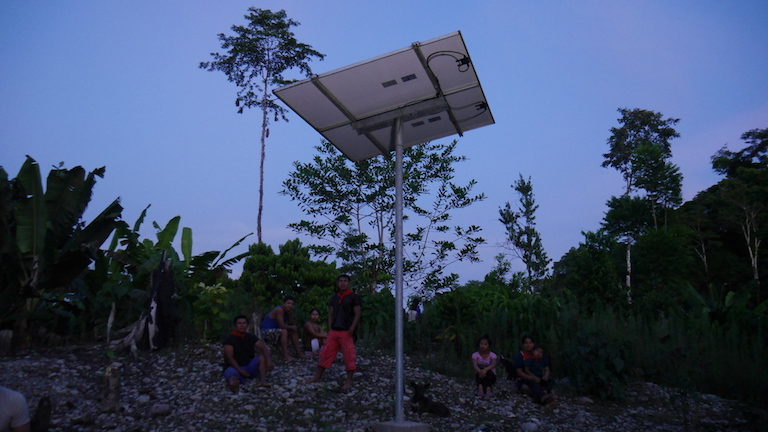 A solar panel in Babure, a village of the Kofan indigenous people, at dusk. Image by Dan Collyns for Mongabay.