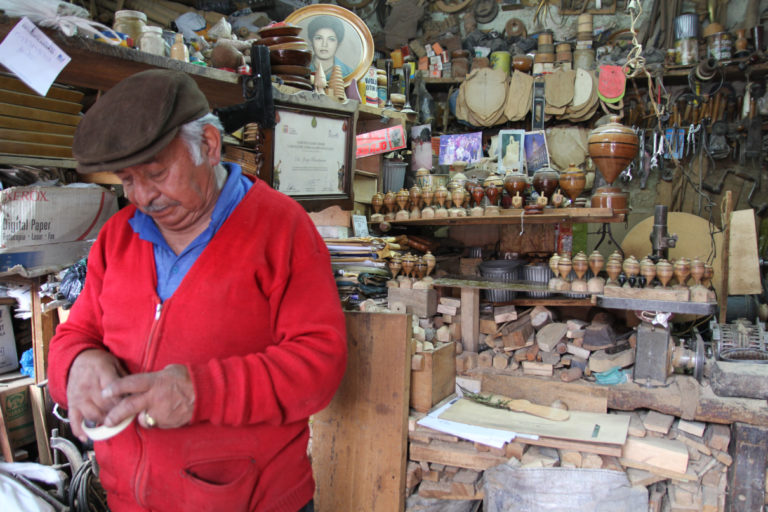 Jorge Rivadeneira Granda at his shop and workshop in Quito, Ecuador. Photo by Kimberley Brown for Mongabay.
