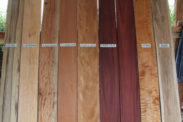 The popular types of wood from the northern Amazon province of Succumbios, used in construction projects in the city, shown at a lumber yard in Quito suburb of Tumbaco. Simbana uses Laurel and Colorado Fino, left over from her husband's projects. Photo by Kimberley Brown for Mongabay.