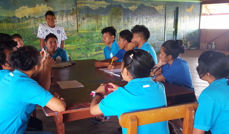 Student government president Gaymon Edwards leads a meeting of his fellow students. Their current requests from the school administration include sprinklers for the kitchen garden, new locks for the classrooms, and full electricity in the dorms. Image by Carinya Sharples for Mongabay.