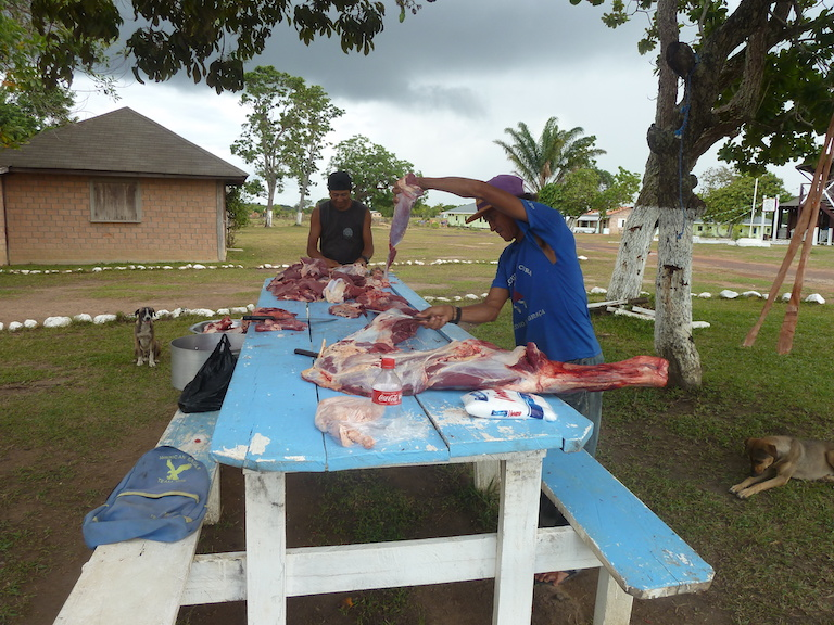 Visiting butchers carve part of a cow for the Youth Learning Centre's kitchen. The students cook breakfast every weekday morning, and all their meals on weekends. Image by Carinya Sharples for Mongabay.