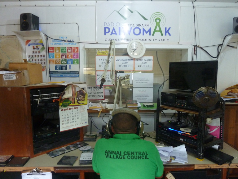 Radio host Mike Williams broadcasts in English and Makushi at Radio Paiwomak, a community radio station located on the same site as the Youth Learning Centre. Students are able to get practice behind the mic. Image by Carinya Sharples for Mongabay.