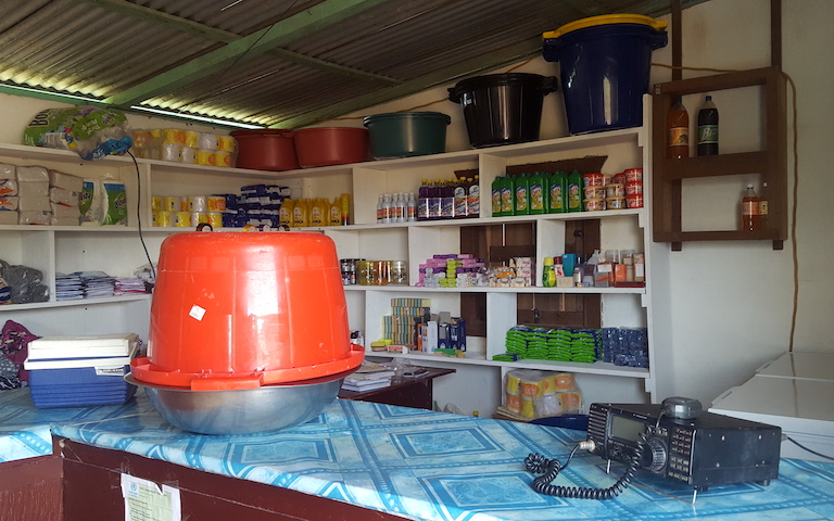 Students can buy groceries and snacks at the school shop. They can also make radio calls to their families living in remote areas without phone connection. Under the bucket is a bowl of dried, salted beef called tasso, a local speciality. Image by Carinya Sharples for Mongabay.